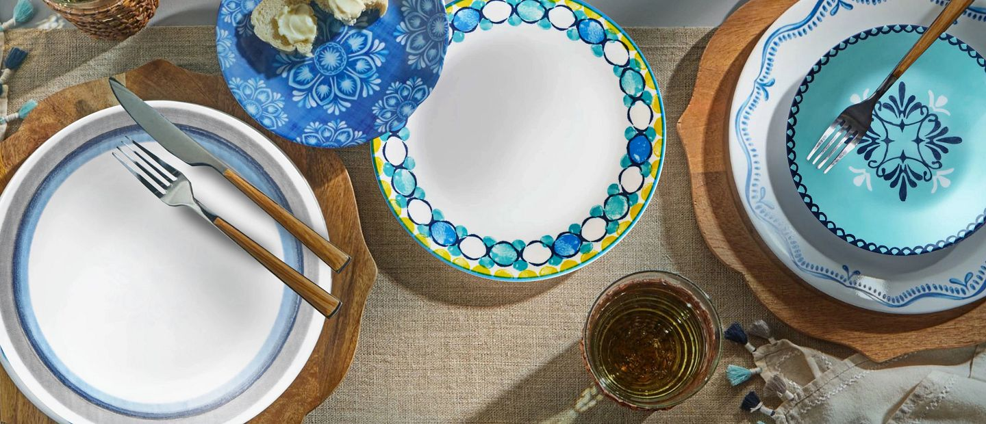 Assorted sizes and styles of Corelle plates