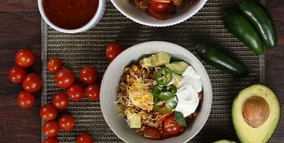 20 Minute Chicken Burrito Bowls served in bowls on the table