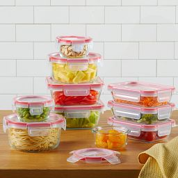 Freshlock™ 20-piece Glass Storage Set stacked on counter with food inside