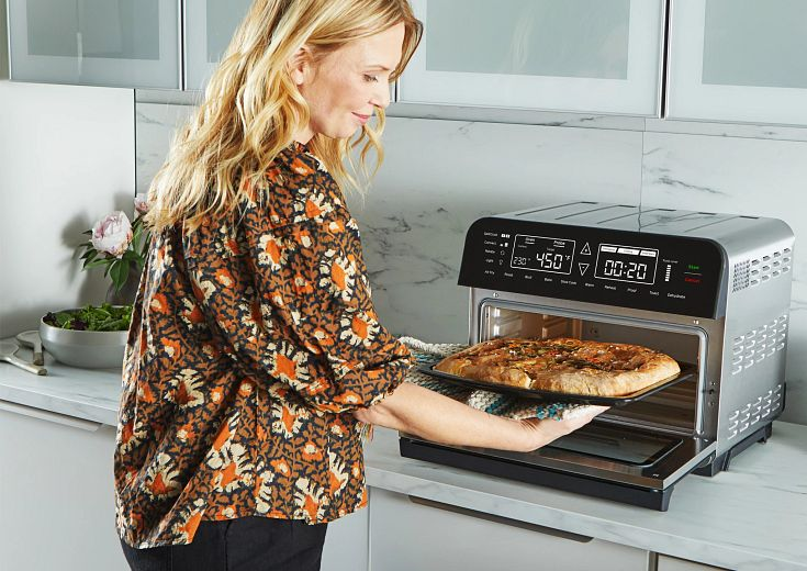 Family in kitchen cooking with Instant omni Pro