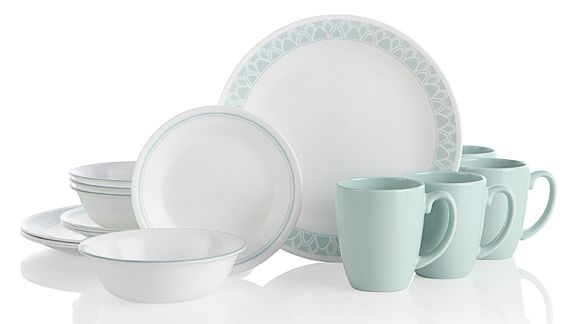 Daleno collection which features a light turquoise rim on white plates and bowls