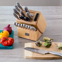 Insignia Steel™ 18-pc Block Set on counter with vegetables