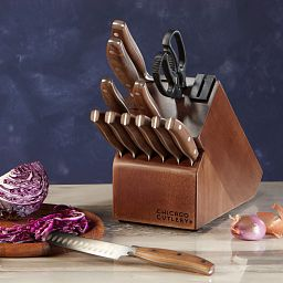 Signature Edge Walnut 13-piece Knife Block Set shown with an onion on a cutting board