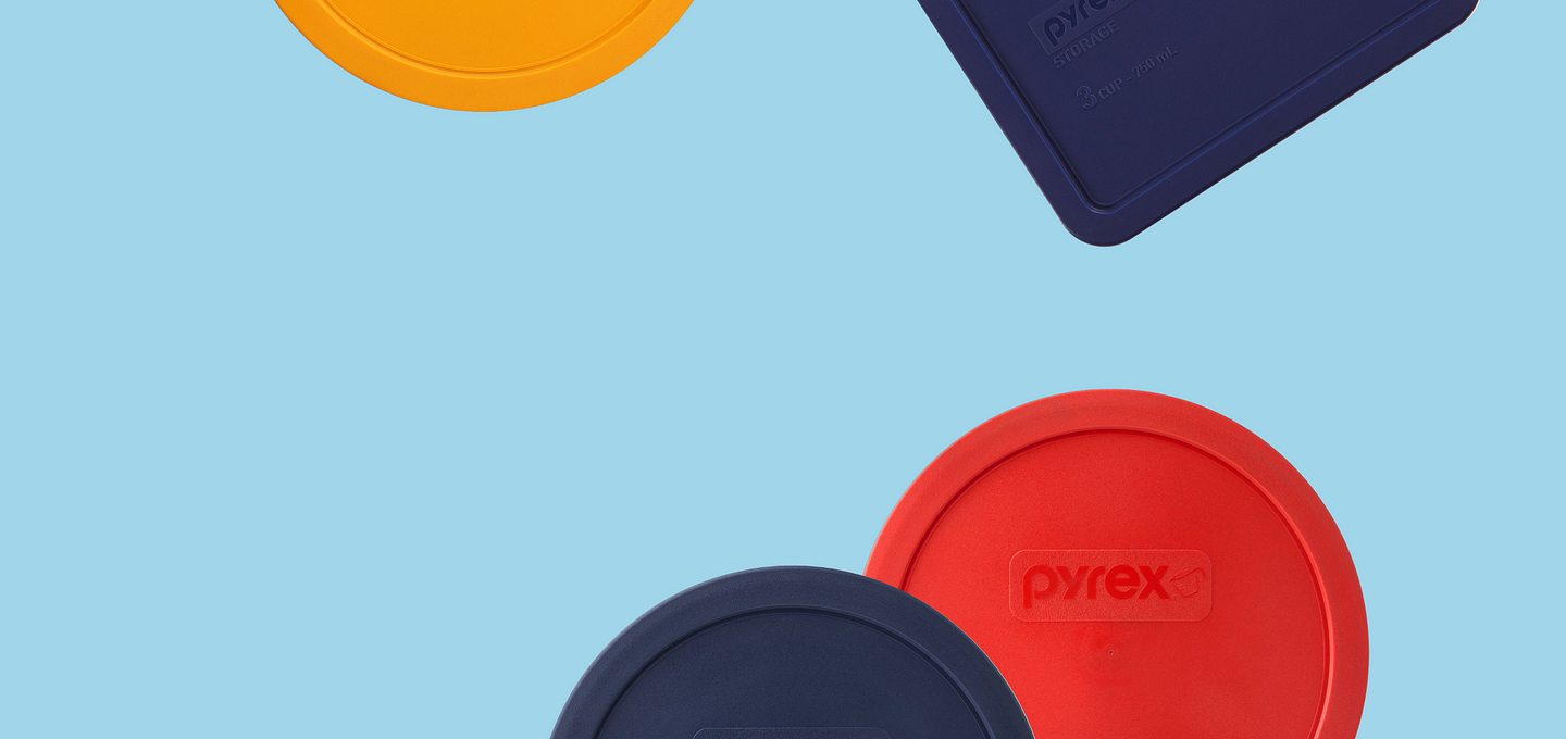 A variety of pyrex lids shown on a blue background