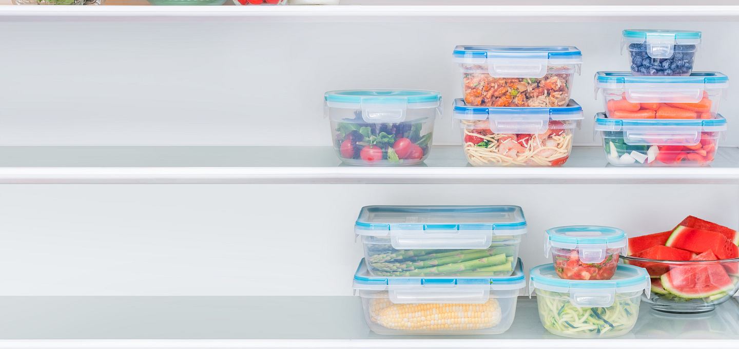 Square plastic Snapware storage showing meals for the week in an open fridge.