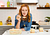Christina Tosi about to take a bite out of her lemon strawberry layered cake made in a Pyrex Deep baking dish