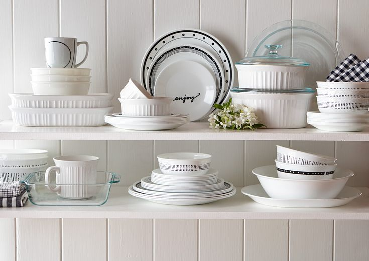 Shelves filled with Corelle plates and Corningware bakeware