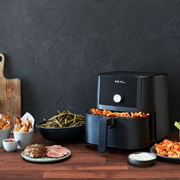 Instant™ Vortex™ 6-quart Air Fryer Oven on counter with french fries and other foods
