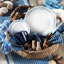 Ocean Blues Dinnerware Set in basket on table