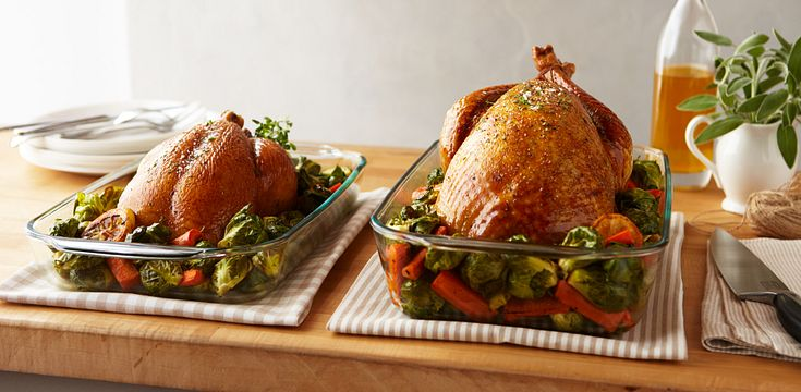 Pyrex Deeper dish shown holding a large turkey next to a Pyrex standard baking dish showing the depth is 50% deeper