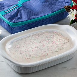 French White® Portable® 3-qt Casserole Portable Set displayed with food