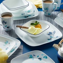 Dalena 16-piece Dinnerware Set on the table with food and drink