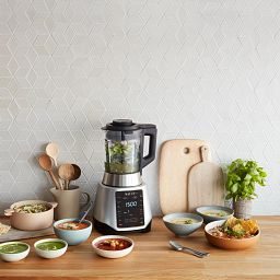 Instant™ Ace™ Plus Blender on the counter with bowls of food