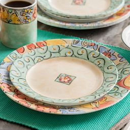 Watercolors 16-piece Dinnerware Set on the table