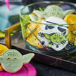 Pyrex Star Wars Yoda decorated storage with star wars cookies in vessel and on table