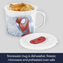 Spider-man 20-ounce Meal Mug™ with food inside and Vented Side laying on the table beside it